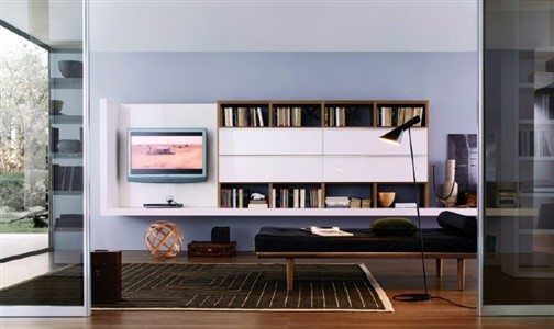 Modern Living Area, MISURA EMME, Mod. Crossing - Misuraemme decomposes and recomposes its range, giving life to various atmospheres. Not draft of simple exercise of style: through its creations, in fact, Misuraemme interprets authentic styles of life. A real innovation refreshes the concept of bookcases. The panels of which it consists, with less weight, allow the bookcase to be hanging giving a very new sense of
